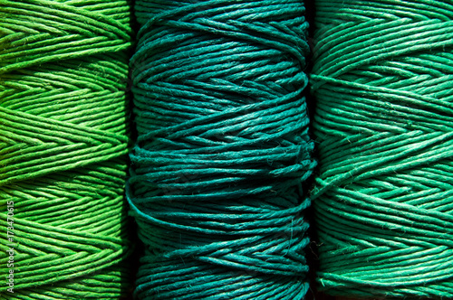 Tuinposter Schip Multicolored sewing threads, background
