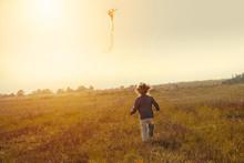 Little Girl Flying A Kite In T...