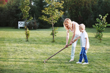 The Boy And His Mother To Rake...