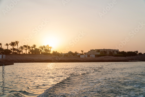 Poster Oceanië Sunset in the city of El Gouna. Waves on the water