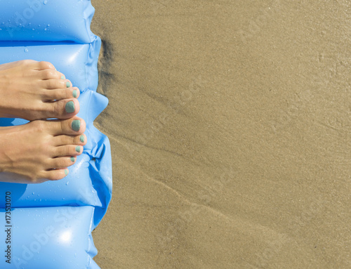 Fotografie, Obraz  Young woman with air mattress on beach.