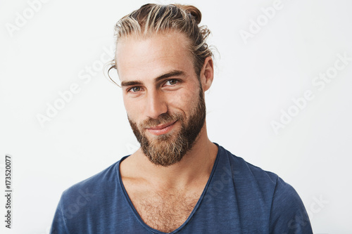 Stampa su Tela Handsome swedish mature guy with great hairstyle and beard smiling, looking in camera with confident and flirty expression