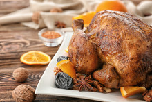 Tasty Roasted Turkey With Slices Of Orange And Prune On Plate