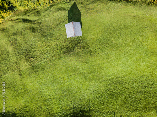 Foto op Canvas Pistache Aerial view of mountain cottage in Swiss mountains