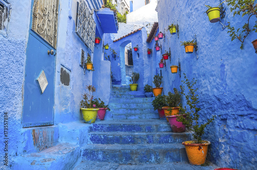 Deurstickers Street with stairs in Medina of Chefchaouen, Morocco. Chefchaouen or Chaouen is known that the houses in this old town are painted in the striking, variously blue hued
