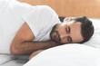 Serene man sleeping on his bed