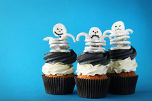 Fresh Halloween Cupcakes With Skeletons On Blue Background
