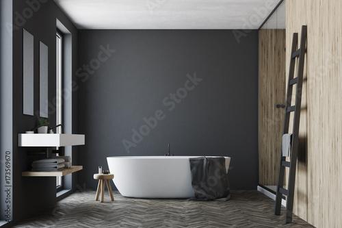Black and wooden bathroom, white tub Fototapeta
