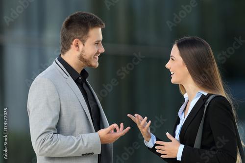 Valokuva  Couple of executives talking on the street