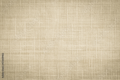 Fotobehang Stof Old jute hessian sackcloth canvas sack cloth woven texture pattern background in aged yellow beige cream brown color