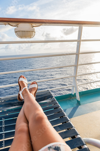 Cruise Ship Travel Woman Relaxing Sun Tanning Onboard On Deck Balcony Lying  Down On Lounger Chair