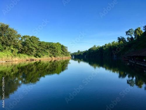 Valokuva  Symmetry, river tree and sky