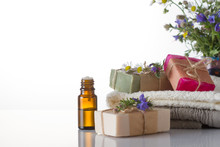 Essential Oil, Handmade Soap, Towels And Flowers.Spa Concept