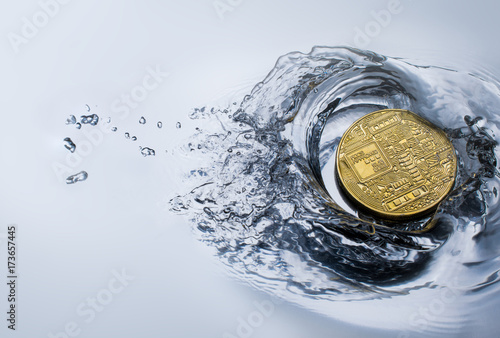 Fototapeta golden bitcoin coin with water splash crypto currency background concept. obraz