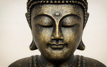 Siddhartha Bronze Statue. Close Up Of Buddha Beautiful Serene Face With Closed Eyes. Best Meditation Inspiration Image Or Mindfulness Background.