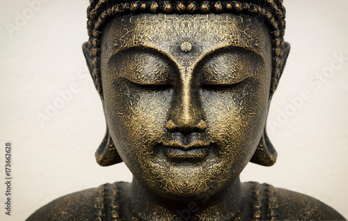 Poster Boeddha Siddhartha bronze statue. Close up of Buddha beautiful serene face with closed eyes. Best meditation inspiration image or mindfulness background.