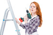 girl with a drill on a stepladder posing on a white background