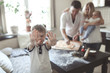 boy smeared with flour and his parents with baby