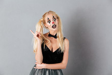 Pensive Blonde Woman In Halloween Make Up Having Idea