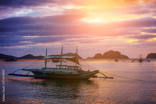 Canvas Prints Red Beautiful sunset with fishing boat