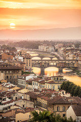 Panel Szklany Mosty Aerial view of Florence at sunset with the Ponte Vecchio and the Arno river, Tuscany, Italy