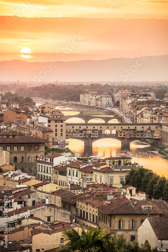 Aerial view of Florence at sunset  with the Ponte Vecchio and the Arno river, Tuscany, Italy Fototapete