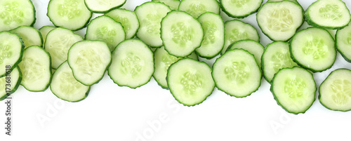 Slices of fresh cucumber on white background
