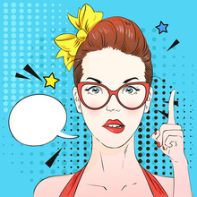 Pop Art Surprised Woman Face With A Finger Raised And Glasses. Comic Woman With Speech Bubble. Vector Illustration.