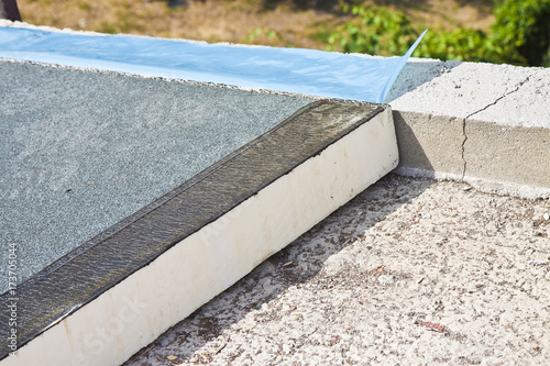 Obraz Roof thermal insulation with polystyrene panels covered with waterproof membrane under a concrete screed - Image with copy space - fototapety do salonu