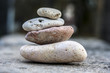 Sea glass pebbles are stacked on top of each other. concept of unity and team work.