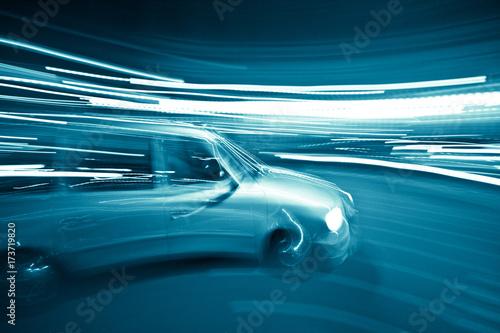 Fototapeta Minivan driving through the streets in motion blur lights obraz na płótnie