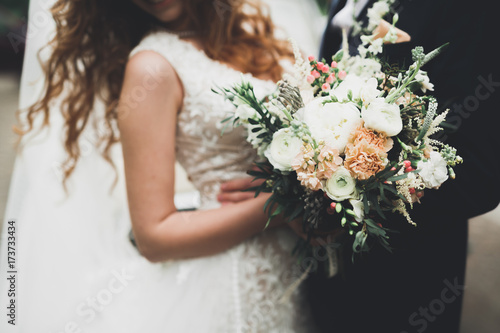 Beauty wedding bouquet with different flowers in hands Tableau sur Toile