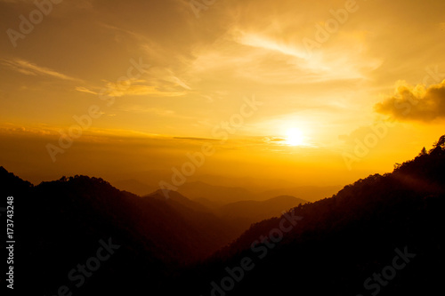 Poster Melon Orange Sunset shine on sky and mountain in evening time