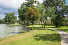 Shady Path Leads To Residential Houses By The Lake In Houston, Texas, USA.