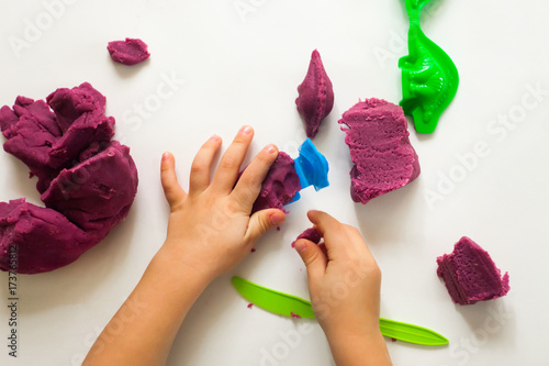 Fotografija Child's hands with colorful clay