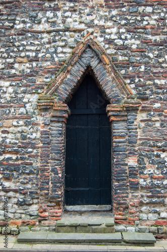 Photo Anglo-Saxon triangular-headed doorway built from reused Roman brick, Trinity Chu