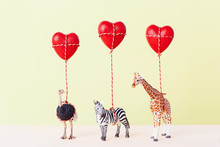 Animal Toys Holding Three Red Heart Balloons.