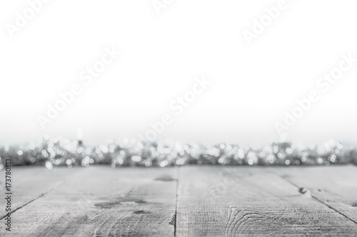 Obraz Black and white Christmas background with rustic wooden surface and soft focus lights and tinsel - fototapety do salonu