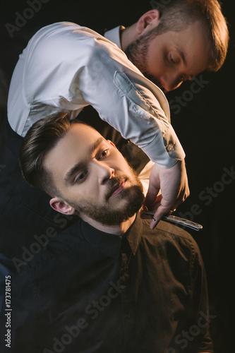 Fotografie, Obraz  Dangerous male shaving with sharp razor
