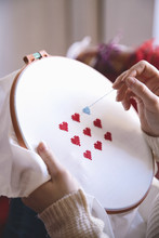 Close-up Of Woman's Hands Doing Embroidery.Valentine's Day