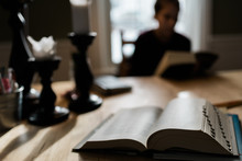 Book With Yon Woman Studying I...
