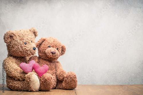 Fotografie, Obraz  Retro Teddy Bear toys pair with handmade Valentines day love hearts front concrete wall background
