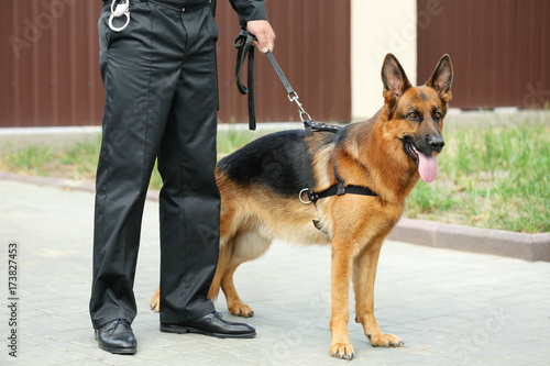 Photo Security guard with dog, outdoors