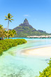 canvas print picture View on Mount Otemanu through turquoise lagoon and overwater bungalows on the tropical island Bora Bora, Tahiti, French Polynesia, Pacific ocean.