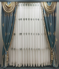 Interior Decoration In Classical Style. Soft Velvet Curtains With Fringe Along The Edge, Contrasting Pelmet Made Of Golden Fabric And Translucent Tulle With Embroidery.