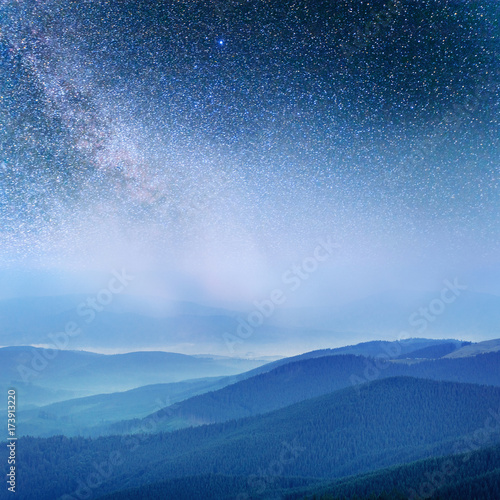Dairy Star Trek in the woods. Dramatic and picturesque scene. Fantastic starry sky and the milky way - 173913220
