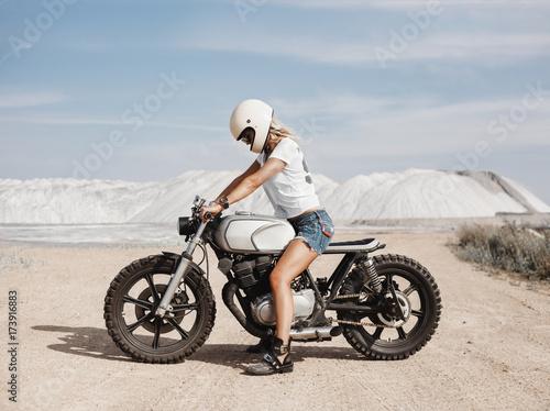 Fototapeta Female on custom built cafe racer motorcycle