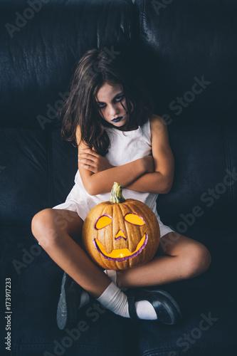 Malicious girl with pumpkin halloween