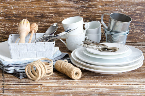 Kitchen Tools and helpers, food photography accessories background. Ceramic cups, silver spoons, linen napkins, wooden utensils, cookware. All you need for cook and make photo.