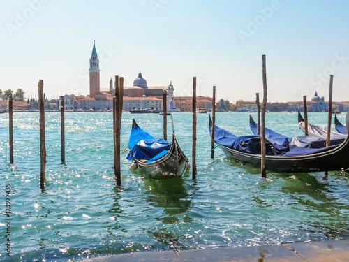 Foto op Plexiglas Venetie Gondolas moored in the Venetian lagoon. Venice, Italy
